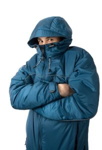 man-getting-warm-in-heavy-blue-jacket